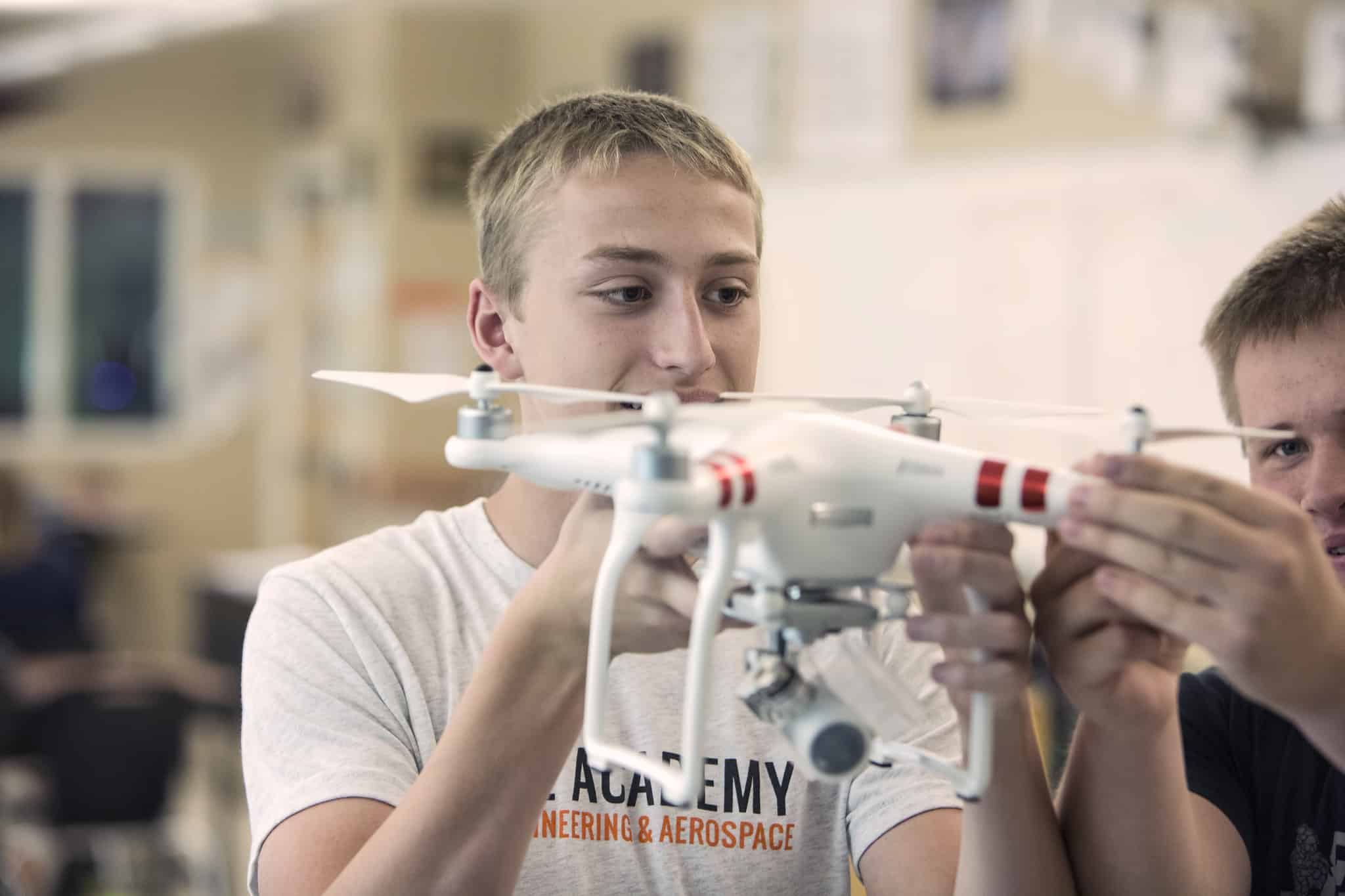 student with a drone