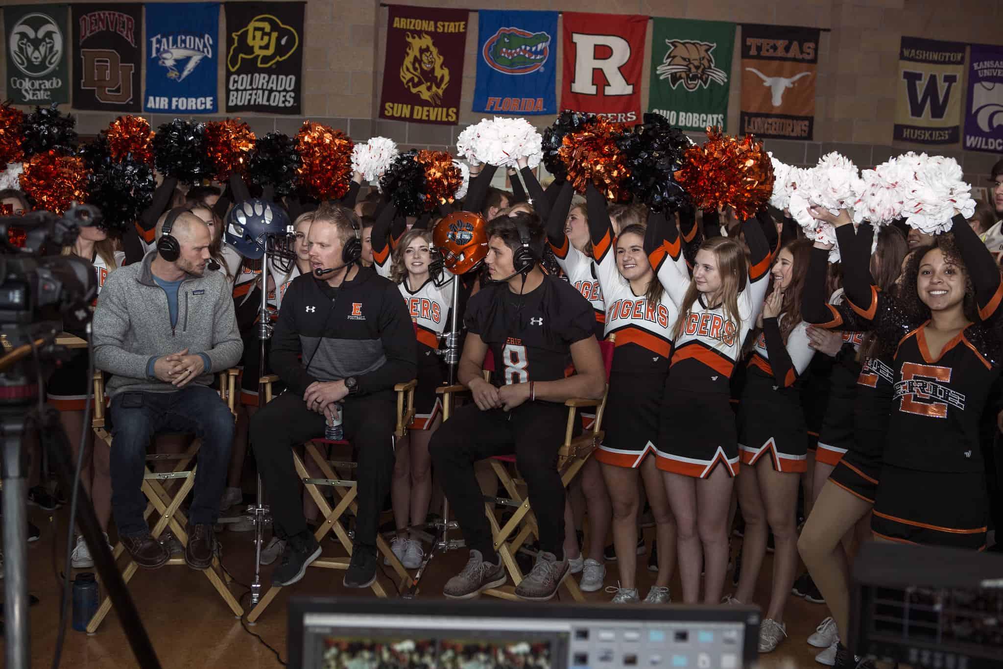 cheerleaders and athletes at a pep rally